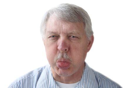 derision: an older man blows a raspberry in a rude gesture