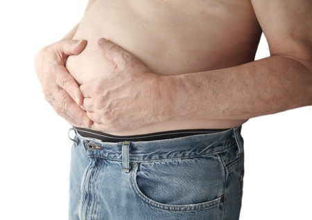 constipation symptom: a man holds his stomach area with both hands Stock Photo