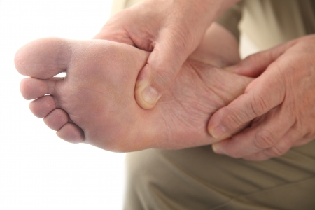 foot pain: close up of the bottom of a man s foot Stock Photo