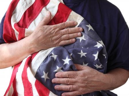 Un homme tient le drapeau américain près de son corps Banque d'images - 14005490
