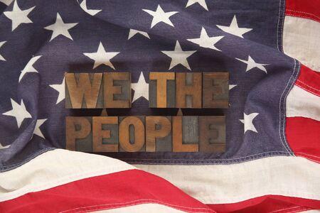 we the people: first words of the Preamble to the Constitution on an old flag Stock Photo