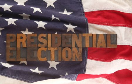 presidential election: old letterpress wood type forms the words presidential election on an American flag Stock Photo