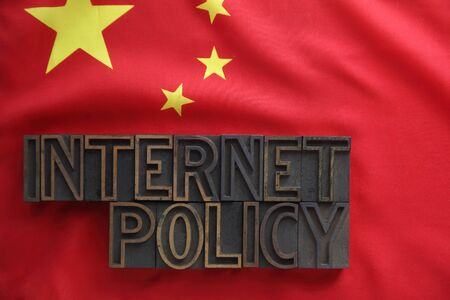 the words internet policy on a Chinese flag photo