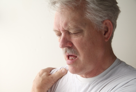 a man suffers from pain in his shoulder