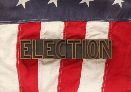 electing: portion of an old American flag with the word election in old wood type
