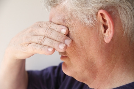 an older man covers his eyes as he is overcome with emotions