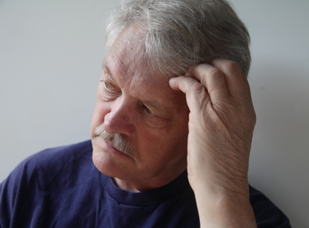 preoccupied: senior man preoccupied with his thoughts
