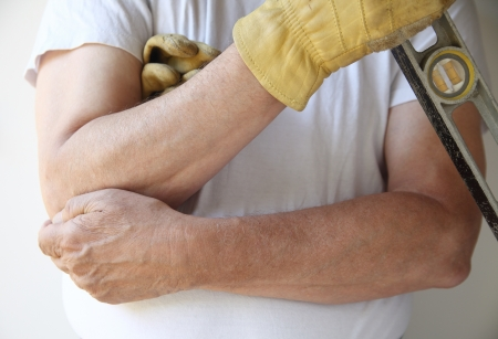 elbow pain: worker is unable to continue his job due to joint soreness
