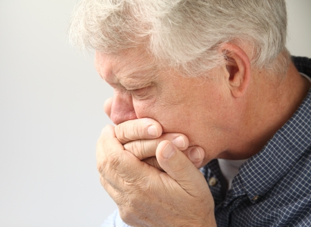 food poisoning: an older man getting ready to vomit