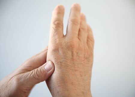 a senior man experiencing soreness in his hand Stock Photo - 16894277