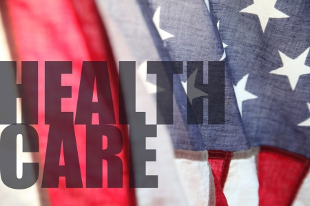 the words health care seen over an American flag
