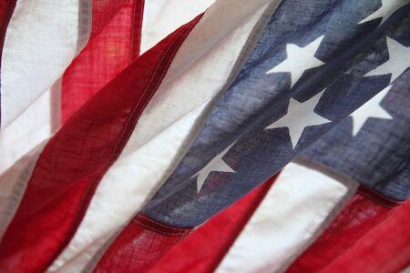 draped: a draped fabric United States flag close up