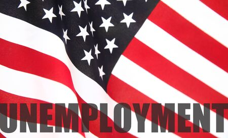 joblessness: the word  unemployment  on a USA flag Stock Photo