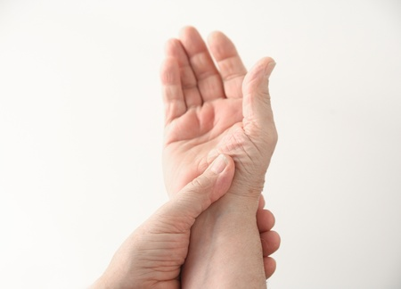 a man with pain at the base of his thumb Stock Photo