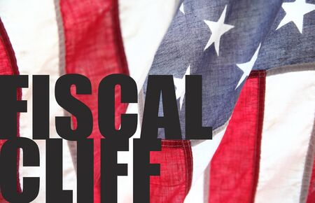 financial cliff: the words  fiscal cliff  on an old American flag