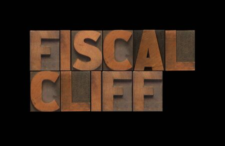 fiscal cliff: the words  fiscal cliff  isolated on black