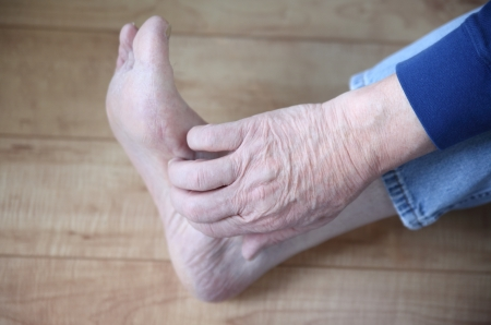 a man s hand on his itchy foot Stock Photo - 17305722