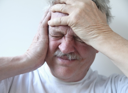 pounding head: older man suffering from pounding head pain