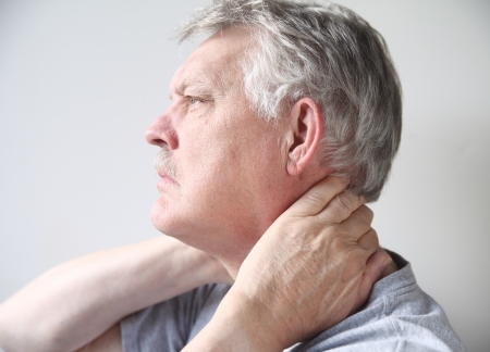 senior man on a neck pain: senior man with both hands on his neck