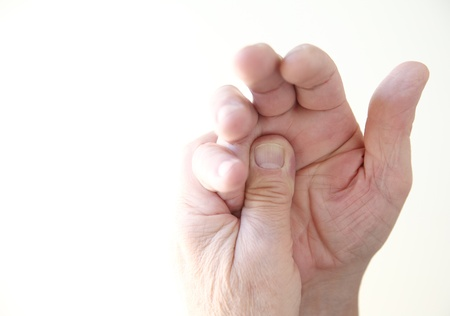 a man with soreness in his hand