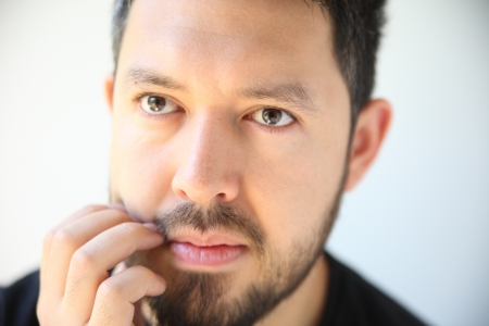 thirty-something man has an irritation in his beard