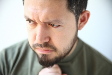 young man with heartburn feels nausea and other heartburn symptoms Stock Photo