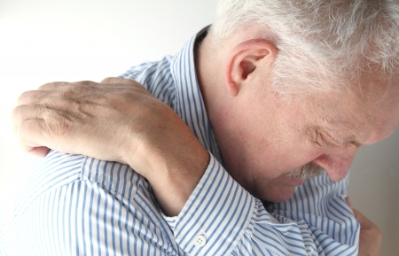 man stretches to reach an elusive itch Stock Photo