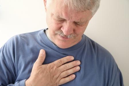 senior experiencing discomfort in his chest