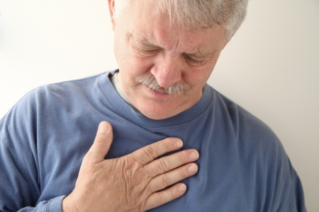 senior experiencing discomfort in his chest photo