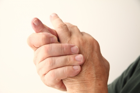 closeup of man with an aching little finger