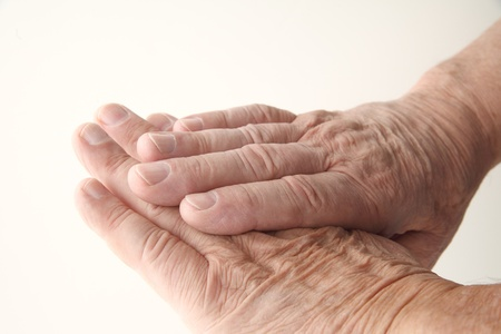 man s: closeup view of a senior man s aging hands