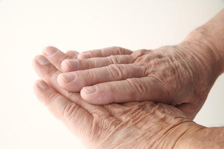 gerontology: closeup view of a senior man s aging hands