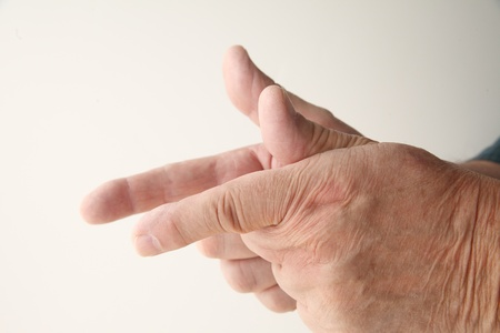 man pretends to shoot guns using his fingers