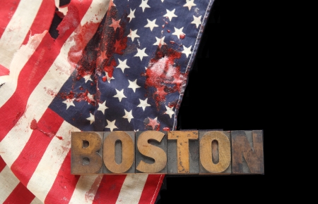 bloodstains: bloody American flag and the word Boston in old wood type on a black background Stock Photo