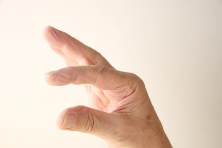 smallness: a man s hand indicating smallness or largeness