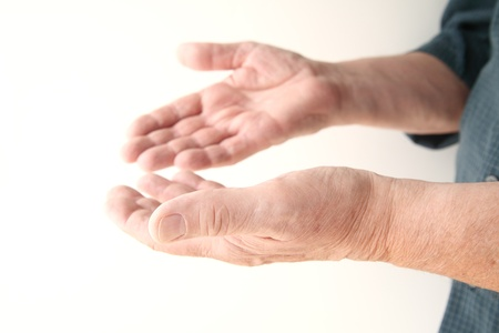 nonverbal: older man using non-verbal communication