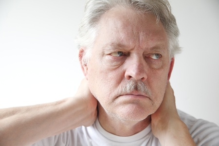 senior man on a neck pain: older man experiences soreness in his neck Stock Photo