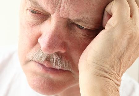 senior man with an unhappy expression