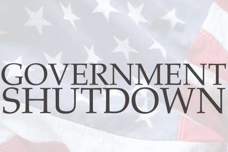 current events: the words government shutdown on an old USA flag Stock Photo