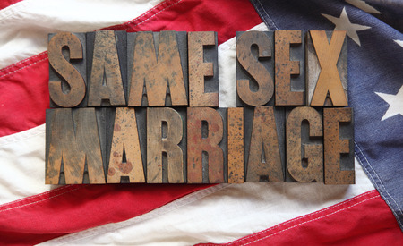 the words  same sex marriage  on an old USA flag