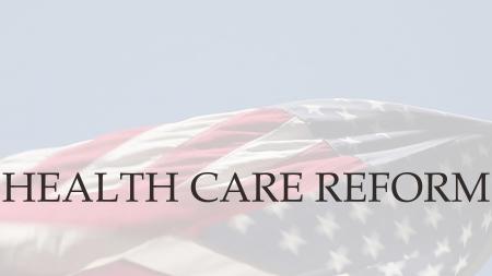 the words health care reform on a USA flag