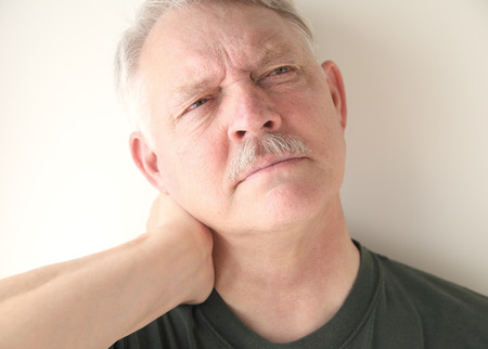 soreness: mature man with soreness in his neck