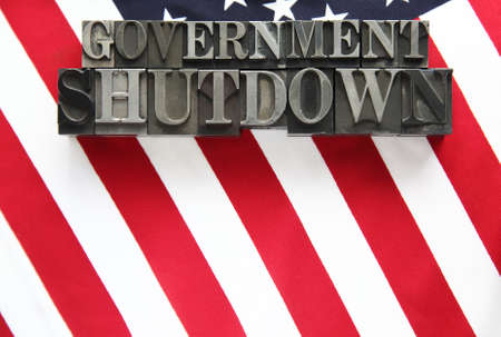 the words government shutdown on an American flag photo