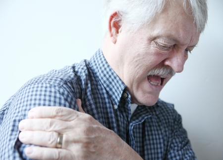 older man with pain in his shoulder