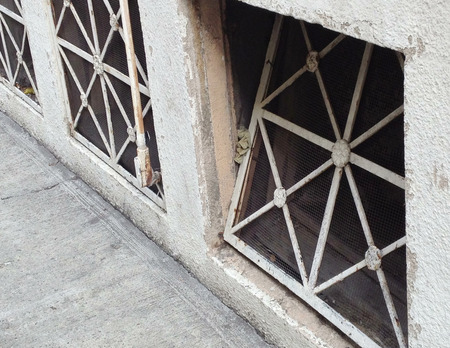 airflow: street level ventilation of an old building Stock Photo