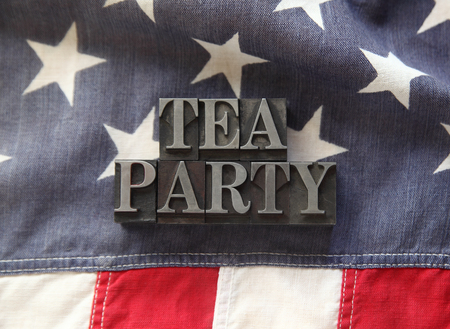 republican party: fabric USA flag with letterpress lead type words  tea party
