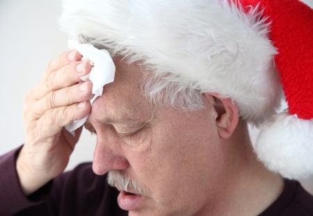 either: older man sweats under either physical or mental holiday stress Stock Photo