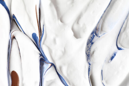 Blue and brown paint on a soft, textured background