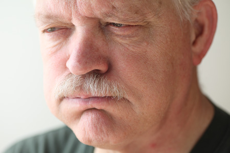 acid reflux: A senior man experiences bloating and reflux from indigestion.