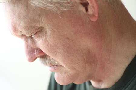 withdrawn: Downcast senior man with an expression of sadness, depression or grief Stock Photo